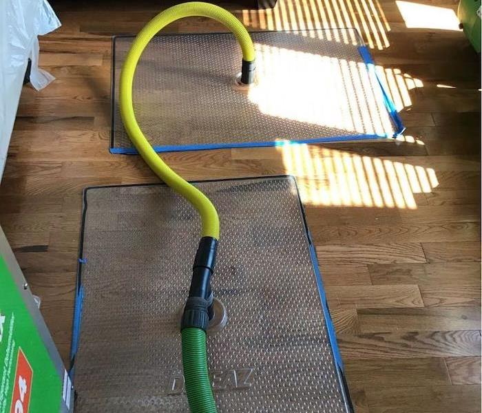 Hardwood flooring with SERVPRO drying mats