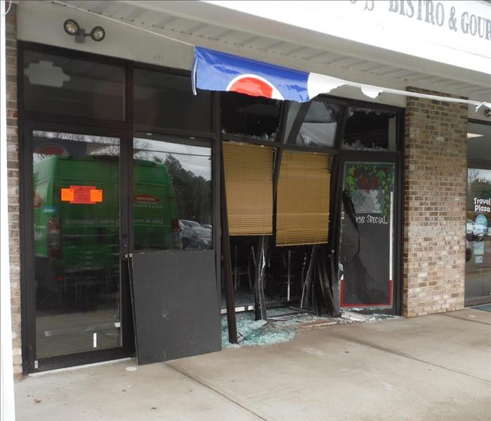 storefront of a shop with broken windows